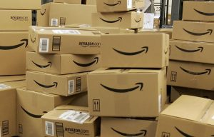 FILE - This Dec. 13, 2005 file photo shows stacks of Amazon.com boxes with merchandise for shipment, at the Amazon.com fulfillment center in Fernley, Nevada. Amazon.com Inc. has signed a deal Monday, Sept. 26, 2011, to stream Fox movies and TV shows to members of its Amazon Prime premium shipping program. (AP Photo/Ben Margot, File)